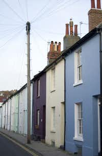 Charming parti-colored flats line the residential quarter of the North Laine district in Brighton, England.