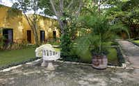 A traditional yucatecan style bench sits in the shade at Hacienda Misné.
