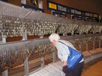 In the Texas Vietnam Heroes Exhibit,  dog tags of the thousands of Texans killed in Vietnam hang in rows.