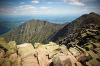 The view from the summit of Mt. Katahdin in Baxter State Park in Maine. Hundreds of thousands of acres of heavily forested interior wilderness, is crowned by Mt. Katahdin (the stateaïs highest peak, at 5,268 feet) in Baxter State Park.