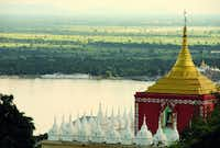 ASIA: Irrawaddy River (Burma aka Myanmar): Pagodas galore are a common sight from the decks of the Road to Mandalay river cruiser.