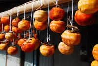 Peeled persimmons are hung to dry in the sun outside a farmhouse on the Kunisaki Peninsula. The trees were introduced to Japan from China many centuries ago.Suzanne Morphet  -  Special Contributor