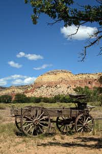An old wagon greets visitors as they enter the main compound at Ghost Ranch in Abiquiu, New Mexico.
