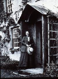 Peter Rabbit author Beatrix Potter is shown at her Hill Top farm in England in 1913.