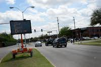 A digital message board warns drivers not to text and drive near Neil Ray McLaughlin Elementary School and Nancy H. Strickland Elementary School while students are released for the day. In March, Farmers Branch passed a new rule making texting and driving illegal in the city.Rose Baca - neighborsgo staff photographer