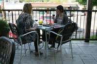 Noël Crotty (left) and Hannah Moore enjoy drinks on the patio at Times Ten Cellars in Lakewood. Times Ten co-founder Kert Platner is involved with the Live Local East Dallas campaign.Staff photo by ANANDA BOARDMAN  -  neighborsgo