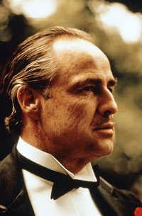 """FILE - This undated image released by Paramount Pictures shows Marlon Brando in a scene from """"The Godfather."""" Dick Smith, the Oscar-winning make-up artist who amused, fascinated and terrified moviegoers by devising unforgettable transformations for Marlon Brando in """"The Godfather"""" and Linda Blair in """"The Exorcist,"""" died  Wednesday, July 30, 2014 in California of natural causes. He was 92. (AP Photo/Paramount Pictures, File)"""
