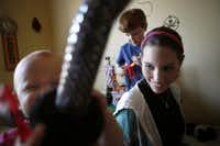 Katie Kellar, 16, (front right) watches Cece Hoff, 1, and Eli Hoff, 5, while babysitting at a Dallas home on Tuesday, March 15, 2011. Katie suffered secretly from obsessive compulsive disorder from ages 12-15. Before she got help, she would rush home after babysitting and bathe and change her clothes to disinfect herself from contact with the kids.