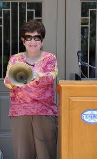 Stonewall Jackson Elementary's former principal, Olivia Henderson, rings the school bell for the last time at the year-end flag ceremony June 11.SUBMITTED PHOTO 219,4,200