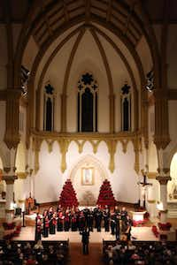 The Orpheus Chamber Singers perform Christmas by Candlelight at the Episcopal Church of the Incarnation in Dallas on Thursday.