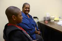 Linda Wooten and her 11-year-old grandson LaDarrian Wooten attend an interview to receive aid from Oak Cliff Churches for Emergency Aid.ROSE BACA