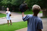 Janelle Rawlston tosses a baseball to her son Matt, 10, at their home in Bent Tree North,  which was ranked the best overall place to live in the Plano, Murphy and Wylie distribution area, according to a data analysis by The Dallas Morning News.