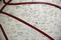 The Highland Park boys basketball locker room features a wall of signatures of past players.Rose Baca - neighborsgo staff photographer