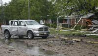 A truck stands outside a nursing home destroyed by an explosion at a fertilizer plant in West, Texas.LM Otero - AP