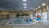 The Plano Aquatic Center reopened in January after a year of reconstruction. The shallow-play area in the foreground now features interactive splash features for toddlers, as well as a clown-fish slide.