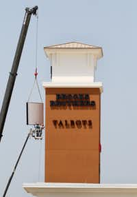 Finishing touches are made to Paragon Outlets signs in Grand Prairie.