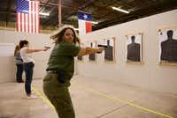 Brenda Newby of Seagoville shoots a round of non-lethal ammunition during a women's self-defense class at Patriot Protection in Plano. The facility opened in September and provides defensive firearms and tactics training.ROSE BACA