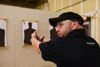 Robbie Allmon instructs a women's self-defense class at Patriot Protection in Plano.Photos by ROSE BACA