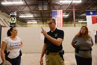 Tim Dodd, owner, helps instruct Leigh Fitzgerald (left) and Thy Dam during a women's self-defense class at Patriot Protection in Plano.ROSE BACA