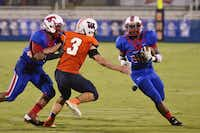 J.J. Pearce's Geoffrey Nwarie (32) runs the ball aganist Frisco Wakeland with blocking help from Gjordan Dumas (35). Pearce's three-game win streak kicked off with its 26-23 win over Frisco Wakeland Sept. 13.