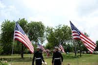 Sgt. Kyle Riley (left) and James Lafarlette, members of the Marine Corps band, walk into the Cedar Hill Pet Memorial Park.ROSE BACA - neighborsgo staff photographer