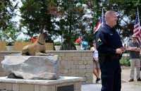 Cpl. J.R. Podany of the Cedar Hill Police speaks to attendees next to a statue of his partner Titus, a Belgian Malinois and member of the Cedar Hill K-9 Unit, at the Cedar Hill Pet Memorial Park during a recent ceremony honoring service pets.Staff photos by ROSE BACA - neighborsgo staff photographer