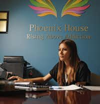 Mariela Torres posed for a portrait in the admissions office at Phoenix House  on Aug. 3. Torres works at the center, dealing with teenage clients with addiction.