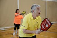 Michael Dalby and Linda Lightfoot play a round of pickleball at the Cedar Hill Recreation Center on Jan. 31, 2014. In late 2012, the recreation center opened two pickleball courts, and an additional court within the last month. Now a group of senior citizens frequently gather to play the sport.ROSE BACA/neighborsgo staff photographer