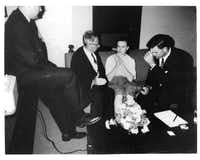 With his foot on table, Howard sits next to tape recorder, running the switch as the agents, through Russian translator Peter Gregory (second from left), question Marina Oswald. Agent Charles Kunkle holds the microphone.Photo by MASON LANKFORD
