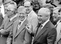 Ambassador Robert Strauss, special trade negotiator, rests a hand on the shoulder of President Jimmy Carter, following a Rose Garden signing ceremony for a new trade liberalization bill at the White House in Washington on July 26, 1979. Carter said the bill would create jobs, spur exports, and enhance prospects for peace.Dennis Cook  -  AP