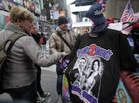 Tourists look at Obama memorabilia at a street vendor's table in New York's Times Square on Wednesday.