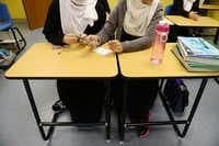 Students build a rocket out of a straw. Principal Qadeer Qazi and Richardson Mayor Laura Mackza said the school fills an education void for local Muslim girls.Rose Baca - neighborsgo staff photographer