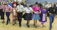 """Dancers during the """"Grand March"""" at the Dixie Chainers Square and Round Dance Club at the senior center in Farmers Branch."""