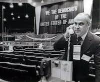 Robert Strauss, chairman of the Democratic National Committee, checks out one of the delegates' telephones at the Kansas City Auditorium, site of the Mid-Term Democratic Party Conference. The telephones connect the delegations with the speaker's podium.ASSOCIATED PRESS