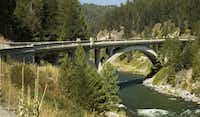 Graceful Rainbow Bridge spans the Payette River. Rainbow Bridge is located on the Payette River Scenic Byway through Idaho.