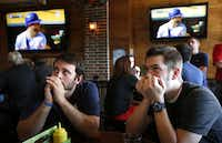 Josh Penny (left) and Phillip Mitchell, both of Rowlett, watched rally hopes fizzle as Rangers batter Mike Napoli struck out in the seventh inning. The watch party at Scruffy Duffies in Plano grew even more subdued.