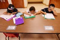 Students (from left) Brenda Arredondo, 7; Alexandra Guzman, 7; and Angel Rincon, 8; do their homework during the after-school program at Wesley-Rankin Community Center in West Dallas. The center is re-examining its programs and coming up with new ways to try to bring stability to West Dallas children and adults.ROSE BACA