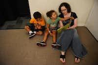 Volunteer Larel Bender reads a book to Da'Marcus Robinson, 3, and Mikayla Hubbard, 5, at The Samaritan Inn, a nonprofit homeless shelter in McKinney on July 30, 2014.Rose Baca  -  neighborsgo staff photographer