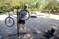 John Lee, parishioner of Episcopal Church of the Ascension in Lake Highlands, repairs a donated bicycle in the church parking lot in Dallas. The church is participating in a new initiative called A Ride Home, where bikes are given to the homeless congregation, The Gathering. The congregation meets to worship every Sunday afternoon at Thanks-Giving Square in Dallas.Photo by ROSE BACA  -  neighborsgo staff photographer