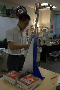 North Hills junior Victor Yip works on a robot at the Irving charter school. Yip, like many of his teammates, has a passion for engineering.Kunz Mainali - Contributor