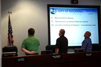 Council member Mike Townsend (from left), Mayor Pro Tem David White, and Rockwall Mayor David Sweet recite the Pledge of Allegiance before a City Council meeting on March 17. Sweet plans to resign from his role as mayor in December before taking office in 2015 as Rockwall County judge. In June, the council will choose a new mayor pro tem who will serve as mayor for five months until the May 2015 election.Rose Baca - neighborsgo staff photographer