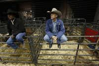 Dr. Tandy Freeman (right) kept an eye out for injuries at a bull riding event in Allen in November. The vast majority of rodeos still have only an ambulance crew to care for the injured.Photos by Nathan Hunsinger  -  Staff Photographer