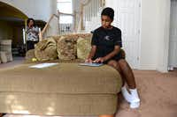 Roman Scott, 11, types on an iPad at his home in Cedar Hill. Scott was diagnosed with autism when he was 18 months old and by age 4 his symptoms were cured with the help of his mother Elizabeth who worked with him several hours a day since the diagnosis. Now, Roman, a  student at Life School in Red Oak, recently earned perfect scores on all three STAAR tests.