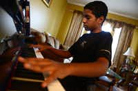 Roman Scott, 11, plays the Chariots of Fire theme song on the piano at his home in Cedar Hill. Scott was diagnosed with autism when he was 18 months old and by age 4 his symptoms were cured with the help of his mother Elizabeth who worked with him several hours a day since the diagnosis. Now, Roman, a  student at Life School in Red Oak, recently earned perfect scores on all three STAAR tests.