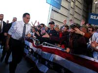 After campaigning in New Hampshire and Iowa, Republican presidential nominee Mitt Romney greeted supporters at a rally in Colorado Springs, Colo. Romney will return to Iowa on Sunday morning to campaign in Des Moines.