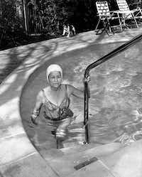 PUBLISHED February 13, 1963 - In freezing weather Federal Judge Sarah Hughes, 66, keeps fit with swims in her heated pool at 3816 Normandy.  Since the fitness fad she's been swimming 50 lengths a day rather than her customary 20.BILL WINFREY/Staff Photographer