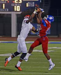 Duncanville senior running back Derrell Haynes (right) goes up for the pass above a Cedar Hill defender in Duncanville's 23-6 loss to the Longhorns on Sept. 27. The loss dropped Duncanville to 3-2 overall and 1-1 in District 7-5A play, while Cedar Hill improved to 3-2 and 1-1.