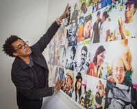 Artist Rick Lowe checked the installation of a photo collage at a Trans.Lation Vickery Meadow gallery. The photographs show residents of the neighborhood.