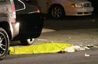 "In this image provided by KEYT-TV, a body is covered on the ground after a mass shooting near the campus of the University of Santa Barbara in Isla Vista, Calif., Friday, May 23, 2014.  A drive-by shooter went on a ""mass murder"" rampage near the Santa Barbara university campus that left seven people dead, including the attacker, and seven others wounded, authorities said Saturday. (AP Photo/KEYT, John Palminteri)John Palminteri - AP"