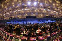 In a photo taken with a fisheye lens, spectators arrive at the Fisht Olympic Stadium prior to the start of the opening ceremony of the 2014 Winter Olympics in Sochi, Russia, Friday, Feb. 7, 2014. (AP Photo/Mark Humphrey)Mark Humphrey - AP